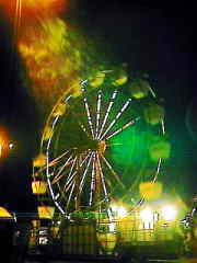 Exact positioning of camera under street lamp over ferris wheel